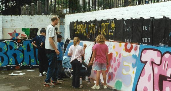 Children painting the walls of Barnard