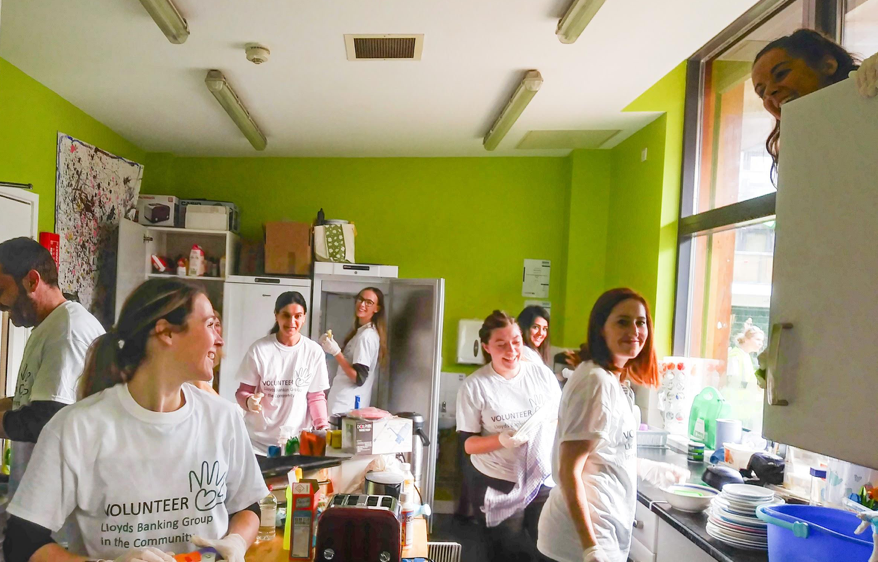 Lloyds bank volunteers in the kitchen at Awesome
