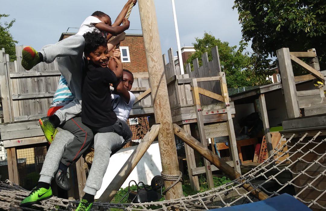 Three adventurers swinging