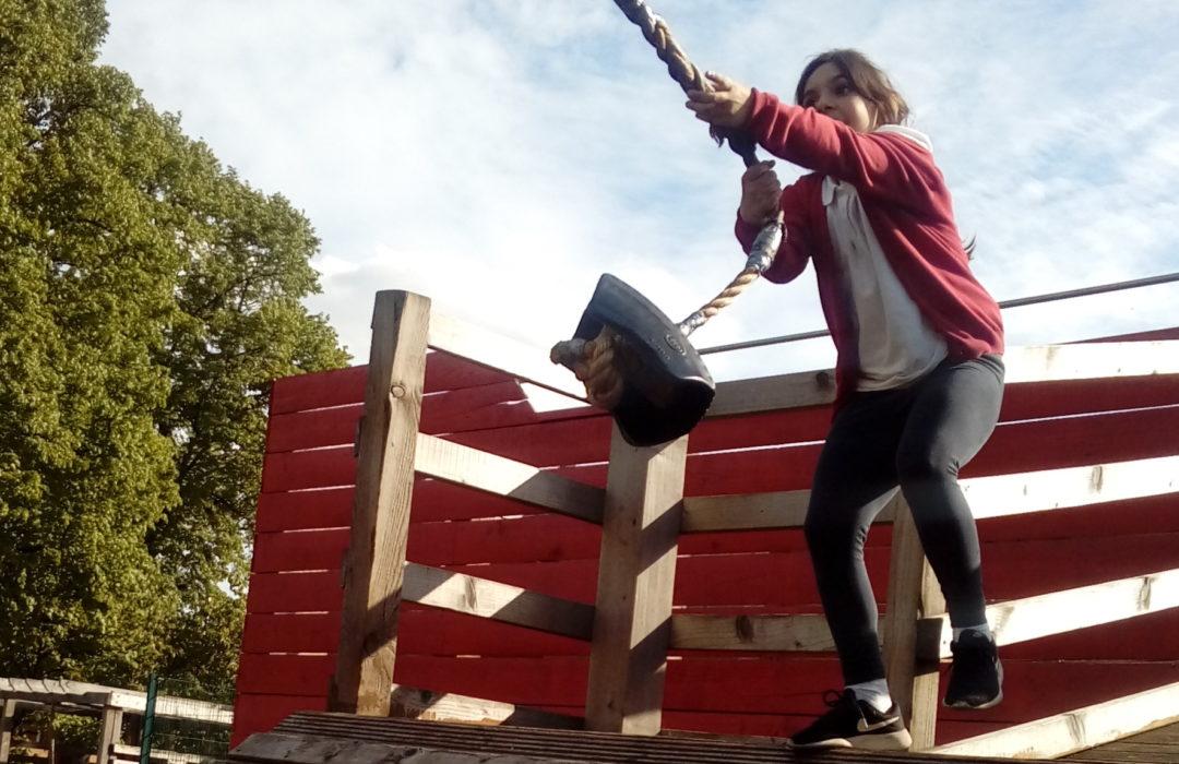 girl using rope swing
