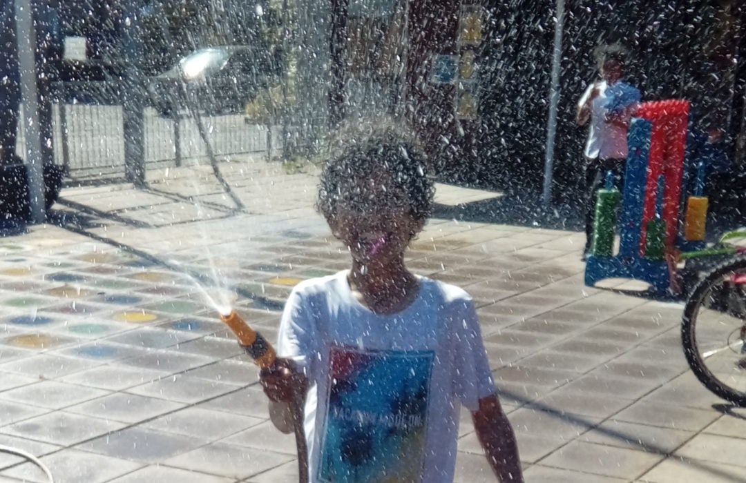 child with hose