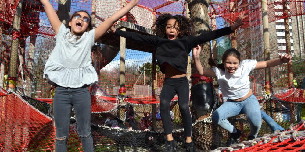 Children jumping on a net