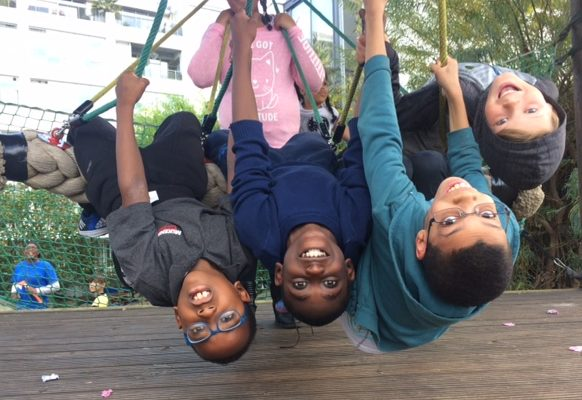 four boys hanging upside-down