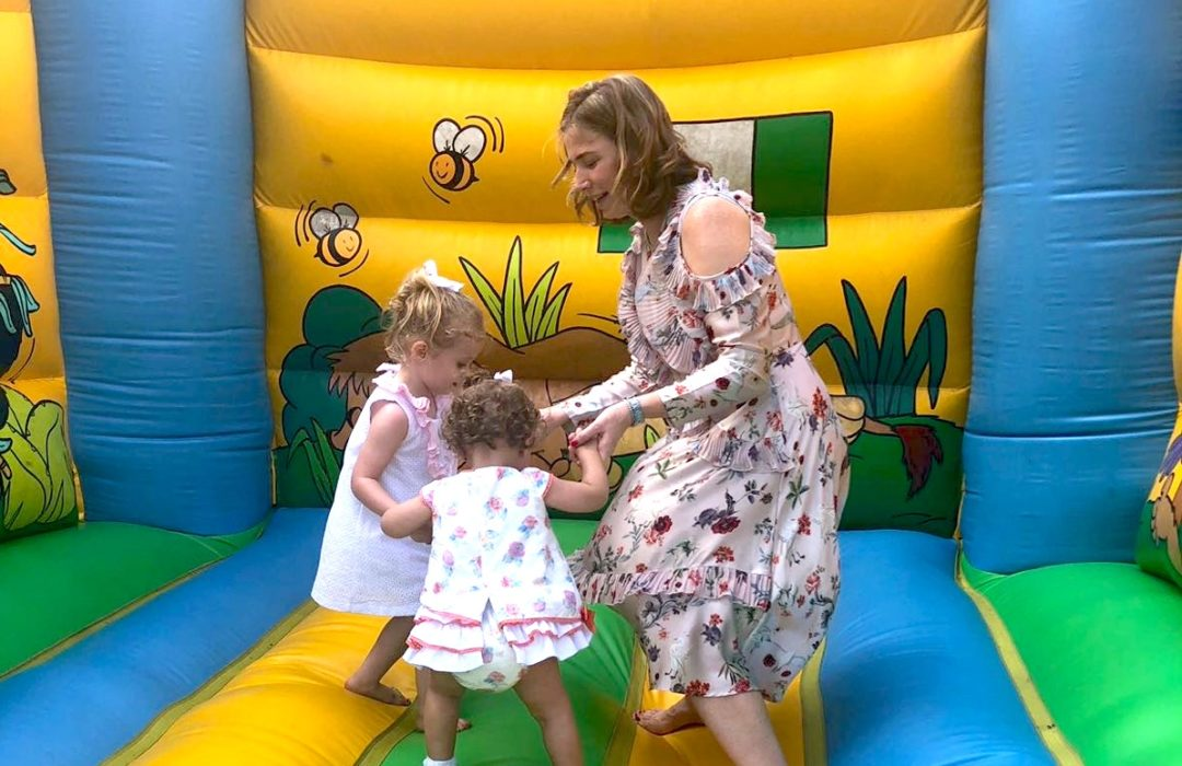 woman and two children on bouncy castle